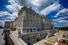 Royal Palace of Madrid perspective in Spain (` Toshio ') Tags: toshio madrid spain europe royalpalaceofmadrid architecture european europeanunion spanisharchitecture spanish building clouds palaciorealdemadrid cars people palace columns fujixe2 xe2