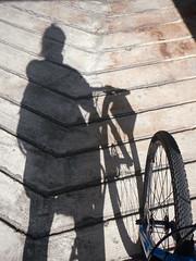 049/365: shadow rider (Michiko.Fujii) Tags: shadowsandlight shadow shadows shadowcyclist girlsonbikes commute shadowsonconcrete concrete