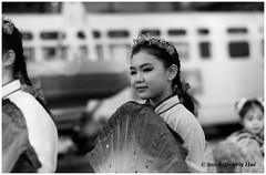 Girl With The Fan - Chinatown XT5382e (Harris Hui (in search of light)) Tags: harrishui fujixt1 digitalmirrorlesscamera fuji fujifilm vancouver richmond bc canada vancouverdslrshooter mirrorless fujixambassador xt1 fujixcamera fujixseries fujix fuji56mmf12 fujiprimelens fixedlens girl girlwiththefan bw blackwhite incamerabwfilmsimulation chinatown vancouverchinatown portrait candid street streetcandid