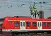 Friedrich III on the S-Bahn, Koln, Germany. 2009 (Brit 70013 fan) Tags: hohenzollernbridge hohenzollernbrucke koln cologne germany 2009 sbahn statue railway train carriage