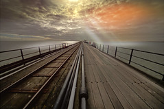 The Edge.. (KissThePixel) Tags: edge horizon shoreline pier longpier woodenpier fence sea seascape cloudscape clouds nikon nikond750 landscape traintrack track path sun sunlight sunset sky skyscape essex thamesestuary thames sunbeam history architecture gradeii listedbuiling earth