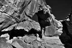 A Sideward View of the Hickman Bridge (Black & White, Capitol Reef National Park) (thor_mark ) Tags: anseladamslookfromcapturenx2 azimuth337 blackwhite blueskies canvas capitolreefnationalpark capturenx2edited centralutahplateaus colorefexpro coloradoplateau day3 desertlandscape desertmountainlandscape desertplantlife fishlakeplateau hickmanbridge hickmanbridgetrail highdesert intermountainwest landscape layersofrock lookingnnw monocline naturalbridge nature nikond800e outside portfolio project365 sunny utahhighdesert utahnationalparks2017 waterpocketfold waynewonderland utah unitedstates