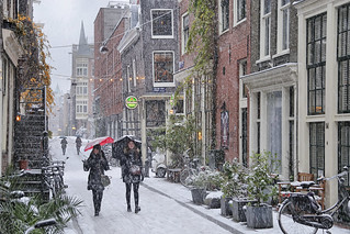 Strolling in the charming Jordaan as the snow whirls down