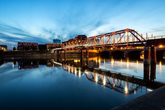 Hawkeye 014 (Cycle the Ghost Round) Tags: des moines iowa office night skyline bridge downtown city cityscape river modern architecture outdoors united states bridges beautiful lights travel landscape new building tourism urban american tower america usa midwestern flyovercountry water reflection
