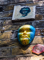 The Anon Portrait (Steve Taylor (Photography)) Tags: 45678910 skullandcrossbones mask thesecretsocietyofsupervillainartists plaque art graffiti streetart blue green grey brown yellow red eerie creepy concrete man uk gb england greatbritain unitedkingdom london