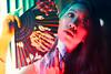 Amoy Illumination (Jon Siegel) Tags: nikon d810 sigma 50mm 14 sigma50mm14 sigma50mmf14art woman girl beautiful beauty fan pattern chinese chinatown singapore singaporean people neon experimental portrait night colourful colors bright