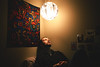 (iannuccisarah) Tags: lantern light contrast pattern tapestry african patterning design color colorful man looking squinting bright dorm scranton pa bed gaze portrait canon 28 mm f 28mm f28 rebel xsi