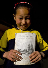 North Korean girl holding an english class book, Kangwon Province, Chonsam Cooperative Farm, North Korea (Eric Lafforgue) Tags: 7087 anbyoncounty asia asianethnicity child children chonsam classmates communism countryside dictatorship dprk education elementary elementaryage elementaryeducation elementaryschool englishbook face girl girls headandshoulders humanbeing kangwonprovince knowledge learning lookingatcamera mangyongdae northkorea northkorean occupation oneperson people portrait propaganda school smile studying teaching vertical chonsamcooperativefarm 北朝鮮 북한 朝鮮民主主義人民共和国 조선 coreadelnorte coréedunord coréiadonorte coreiadonorte 조선민주주의인민공화국 เกาหลีเหนือ קוריאההצפונית koreapółnocna koreautara kuzeykore nordkorea північнакорея севернакореја севернакорея severníkorea βόρειακορέα