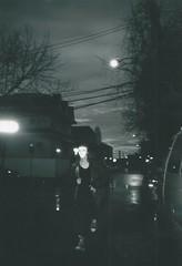 RUN ll (fakeversaci) Tags: newyork nikonl35ad night rain gloomy contrast lights street run dark queens veronica lupo