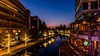 The Woodlands Waterway in Spring/Woodlands TX, just after sunset, during the blue hour. (darwinmacon) Tags: nikon d850 river water bluehour sunset cityscape city 20mm18g sunstar starburst texas nightphotography nightscape night