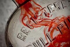 In A Bottle (ertolima) Tags: pint water hmm macro red macromondays inabottle glass