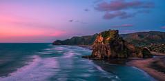 Piha put on a sunset show for me! Piha Beach, North Island, New Zealand (christaff1010) Tags: landscape sunset water panorama auckland sea longexposure summer newzealand ocean piha pink clouds sky sunlight hills northisland sun nz