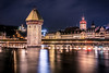 Winter nights in Lucerne (mscgerber) Tags: switzerland schweiz lucerne luzern europe europa water river bridge bridges architecture building wood oldtown town city cityphotography cityscape view stars night nightphotography nightsky dark mood moody sky