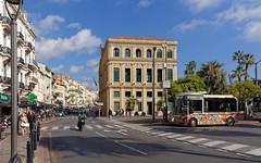 Cannes / Rue Félix Faure / Mairie (Pantchoa) Tags: cannes france côtedazur ville mairie architecture ruefélixfaure hôteldeville rue félixfaure bus autobus motocycliste moto pins arbres palmiers nuages perspective o