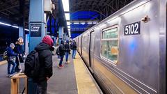Arriving D Train (deepaqua) Tags: brooklyn night scooter offseason winter coneyisland bluehour subway subwaystation dusk