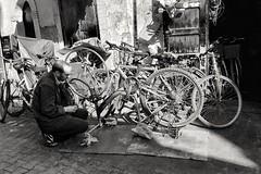 Street bike repair (radimersky) Tags: streetphotography street africa afryka candid ulica zdjęcieuliczne bicycle mechanic mechanik warsztat bike morocco maroko work praca bw blackwhite blackandwhite czarnobiałe raw bicycles life travelphotography travel smartphone samsung7s smg935f essaouira city miasto