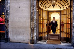 Golden Cage (Steve Lundqvist) Tags: roma rome italy italia italian italiano italians city urban europe light people gente steve lundqvist fujifilm x100 x100s window shop photographer fotografo portrait ritratto streetphotography street photography exploring explore suit man persone reflection golden gold oro vanità cage door condotti via shopping rich