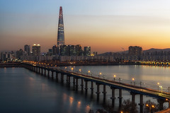 Lotte tower at sunset (Aaron_Choi) Tags: architecturaldetail architecture asia asian bridge capital city citylights destination district famous freeway gangbyeon gangnam han hanriver highway iconic jamsil jamsilrailwaybridge korea korean landmark lights lotte lottetower night nightlight nightview nigthscape railway railwaybridge river road seoul skyscraper songpa subway sunset tourism traffic travel urban urbanlandscape view viewpoint