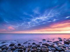 Cobblestones (Jarno Nurminen) Tags: finland porvoo emäsalo filter nisi olympus clouds longexposure shore sea sunset rocks