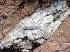 quartz vein cutting granite (peterwallace2) Tags: capegeorgearea hadrynian georgevillepluton granite calcite vein