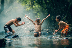 BEE_9913 (Bee-Teerapol) Tags: playing childrens water vietnam indonesia people poor lifestyle happy malaysia cambodia rural child person kid summer caucasian thailand cute enthusiasm myanmar fresh funny face fun space boy outdoor happiness splash sport joy vacation expression laos play aec asian standing recreation sun active wet rustic laugh summertime fantastic muscles strength sunset