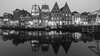 In the mirror (McQuaide Photography) Tags: haarlem noordholland northholland netherlands nederland holland dutch europe sony a7riii ilce7rm3 7rm3 alpha mirrorless 1635mm sonyzeiss zeiss variotessar fullframe mcquaidephotography lightroom adobe photoshop tripod manfrotto light licht water reflection stad city urban waterside lowlight architecture outdoor outside waterfront building river spaarne riverside traditional authentic skyline house houses huis huizen residential winter longexposure calm still nopeople old oldhouse dutcharchitecture 169 widescreen blackandwhite bw mono monochrome kortespaarne deolyphant window windows raam ramen