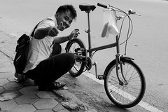 Broken Bike (gergelytakacs) Tags: angkor asia cambodge cambodia fareast kampuchea khmer kingdomofcambodia siemreap bw backpack bag bike blackandwhite blancoynegro broken bycicle bystander calle candid city cycle cyclist damaged documentary feketefehér flâneur grin guy laugh man mending monochrome noiretblanc oil oily pedal photo photography public road rue smile space strada stranger strasenfotografie street streetphotographer streetphotography streetphotgraph streetphotgrapher streetphotgraphy streetphoto streets streetscape thumbsup travel ulica unposed urban urbanphoto urbanphotographer urbanphotography utcafotó улица רחוב ក្រុងសៀមរាប ព្រះរាជាណាចក្រកម្ពុជា