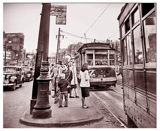 Girl in White Jacket Waits for a Trolley  --  1946