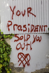 Your President Sold You Out (Mabry Campbell) Tags: harriscounty houston tx texas us usa unitedstates unitedstatesofamerica downtown graffiti image photo photograph photography f80 mabrycampbell january 2012 january62012 201201067292 34mm ¹⁄₄₀₀sec 400 ef2470mmf28lusm