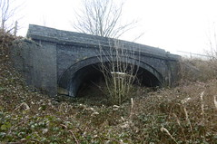 Former railway bridge at Woodend Rd, Mirfield  Huddersfield  (Newtown) - Mirfield  old railway   February 2018 (dave_attrill) Tags: cutting woodend rd bridge junction overgrown trees bushes vegitation huddersfield newtown hillhouse mirfield lmsr london midland scottish railway disused line goods only branch trackbed west yorkshire riding cycle path foothpath ncn connection sheffieldtobradford february 2018