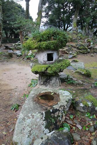 Flora-Enriched Stone Lantern