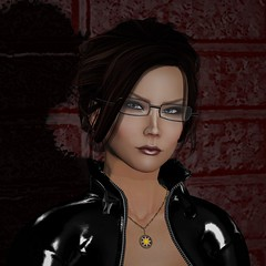 2018's new profile pic (alexandriabrangwin) Tags: alexandriabrangwin secondlife 3d cgi computer graphics virtual world photography new profile picture avatar icon thumbnail shiny glossy black latex rubber catsuit zipped open buckled collar gold ishtar necklace woman hair updo intense look stare camera red painted brick wall update glasses