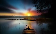 Sun (augustynbatko) Tags: sun lake landscape nature water trees bridge pier sunset sky tre boat tree serene