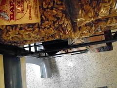 DSC03069 (classroomcamera) Tags: grocery groceries store closeup treat treats snack piece pieces brown tan black red floor look down below