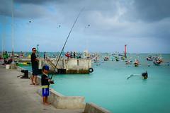 MircK - Sampei (imNOTaPh) Tags: bali indonesia asia ontheroad roadtrip mirck nikon d3100 sky sea blu fisherman boy streetphotography travel travelphotography pier
