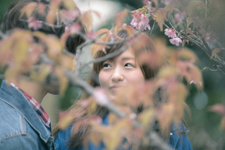 Young couple looking at each other in spring