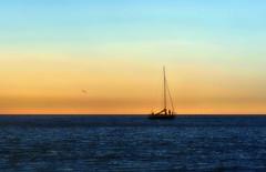 Habia una vez un Velero...!!! (Nita_Fotos) Tags: sun sundown clouds blue orange sol atardecer nubes naranja cielo agua backligh contraluz sailboat velero bote sea mar caribbeansea marcaribe lecheria venezuela tuniñasalvajedelaselva