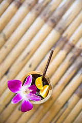 Orange Juice in natural bamboo glass. (baddoguy) Tags: art backgrounds bamboo material banana leaf chef cold drink color image condiment copy space cultures decoration drinking glass straw flower food gourmet group of objects horizontal ice juice lemon fruit lotus water lily multi colored natural condition no people orange orchid petal photography pink readytoeat refreshment sour taste summer sweet thai culture thailand violet