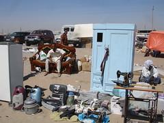 i bet everthing on sofa. (setolee) Tags: fleamarket bazaar people peopleofturkmenistan turkmenistan salesman