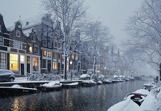 Snow falling in the Jordaan in the early evening