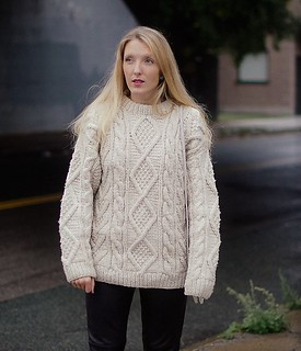 Blonde sexy women in oversize aran wool jumper