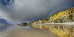 I can't black it out if I wake up and remember (pauldunn52) Tags: rainbow storm wet sand reflections traeth mawr glamorgan heritage coast wales cliffs