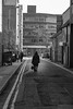 Walk Away (Howie Mudge LRPS BPE1*) Tags: people candid casual alley buildings archtitecture sky road lines pavement moody blackandwhite blackwhite bw mono monochrome monochromatic street streetphotography streetlife outside outdoors atmosphere aylesbury england uk urbanphotography urban february 2018
