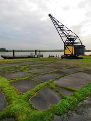 rusting on the dock of the bay... (Mattijsje) Tags: crane kraan hijskraan antiek oud lek water rivier river mos moss holland nederland netherlands dutch loading dock dockofthebay