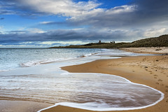 Receding Tide (Chris Lishman) Tags: coast northumberland embleton embletonbay beach sea coastal northeastengland dunstanburgh dunstanburghcastle scenic iconic walking stroll waves tide tidal winter water flow flowing curves shapes castle skies sky
