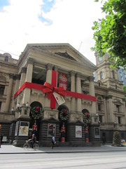 Melbourne Town Hall, wrapped up like a Christmas present, Swanston Street (d.kevan) Tags: australia melbourne cbd swanstonst townhalls christmasdecorations streetscenes arches people decorativedetails architecturaldetails wreaths soldiers lamps columns redribbons clocktowers flowers victoria