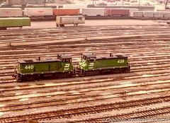 BN 440 and 439, Clyde Yard, 1980-05-29 (redheadedrobbie1) Tags: bn burlingtonnorthern fallenflag emd sw1000 electromotivedivision switcher switchengine shunter railroad railfan diesel locomotive