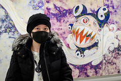 Patron of the Arts (johnjackson808) Tags: vancouverartgallery artgallery vancouver eyes art woman vag people mask streetphotography takashimurakami facemask black fujifilmxt1 downtown