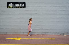 Her way (Evens & Odds) Tags: street photography kidslife brickwall yellow grey oneway streetphotography streetshot arrows directions attitude