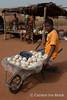 At the market - soap (10b travelling / Carsten ten Brink) Tags: 10btravelling 2018 africa africaine african afrika afrique biankouma carstentenbrink cotedivoire dan elfenbeinkueste foungesso go godufu iptcbasic ivorian ivorycoast touba westafrica yacouba yakouba africain boy cmtb ivoirien ivoirienne man market roadside soap soapballs soapbar tenbrink wheelbarrow